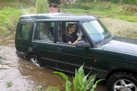 Girls driving 4x4 through water