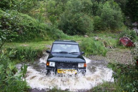 Land Rover driving through river