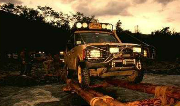 4x4 driving over wooden beams