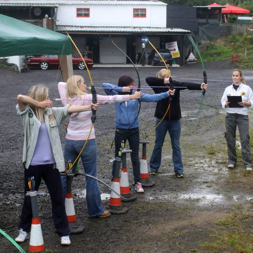4 girls doing archery